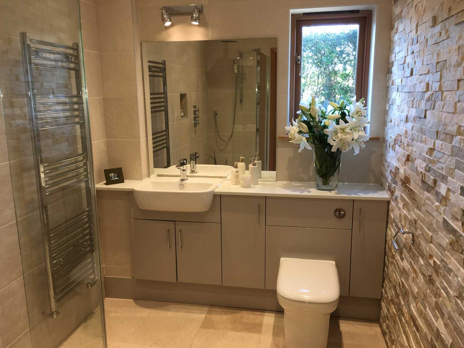 Bathroom Image with split face beige and cream tiles